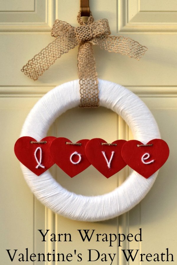 White yarn wrapped wreath with hearts.
