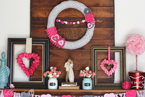 Wooden pallet backdrop with pink, aqua and grey crafts for mantel decor.