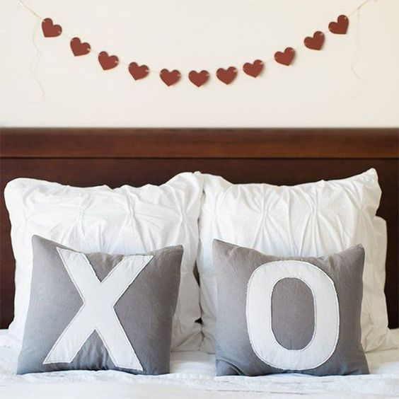 XO pillows & heart garland for bedroom decor.