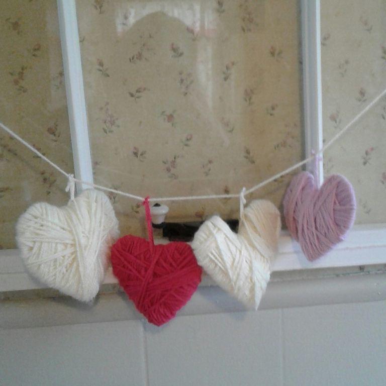 Yarn heart garland for V-day.