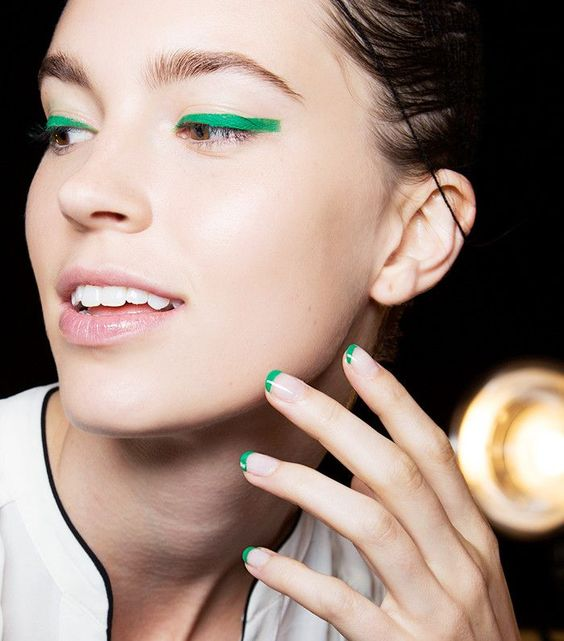 Blunt cat eyes and french manicure for St. Patricks day.