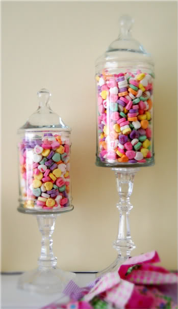 Conversation hearts filled jars.
