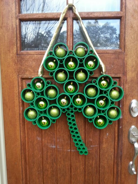 Creative St Patrick's shamrock wreath made from PVC pipe.