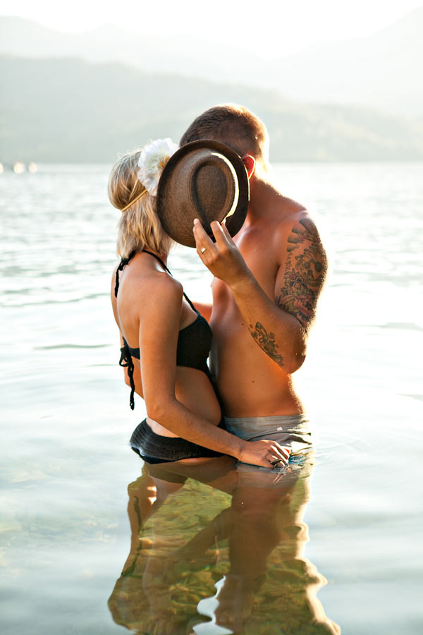 Creative couple photo-shoot inside water.