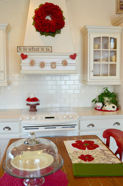 Elegant Valentines day kitchen decor with love banner & floral wreath.