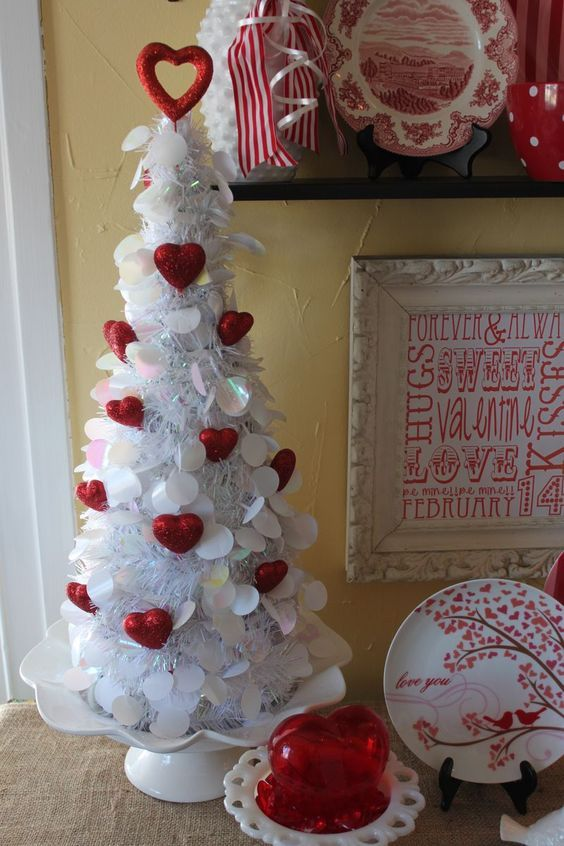 Fantastic white tree decorated with red hearts.