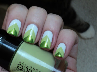 Green and white chavron nails.