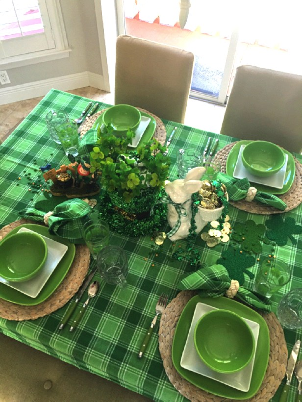 Green plaid table scape with crockery and shamrock for simple table decor.