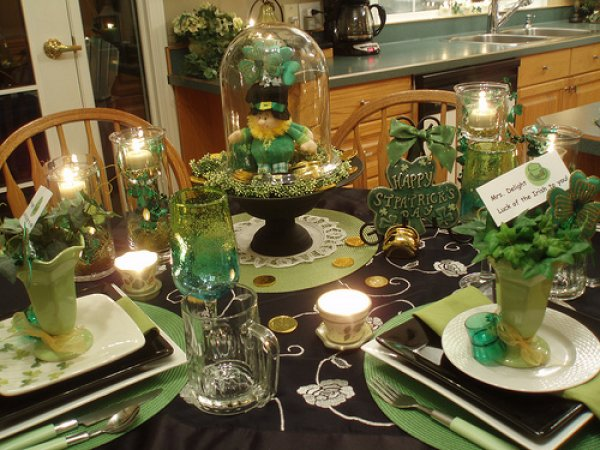 Nice table setting with Leprechaun Under Glass as centerpiece, floating candles and green crockery.
