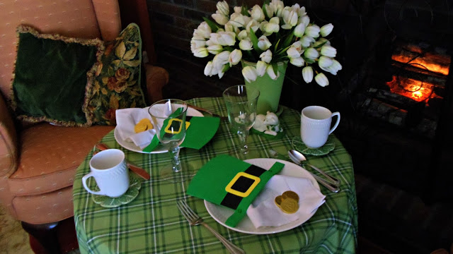 Simple table setting with Leprechaun hats, coins, tulips and green plaid table clothe.