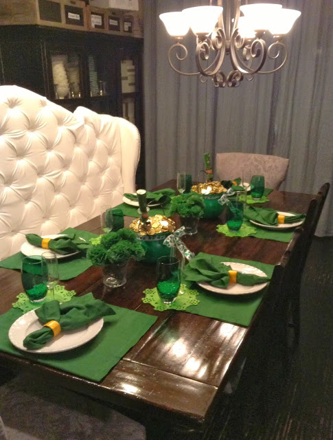 Sober green table decor with lucky irish pot of gold as centerpiece.