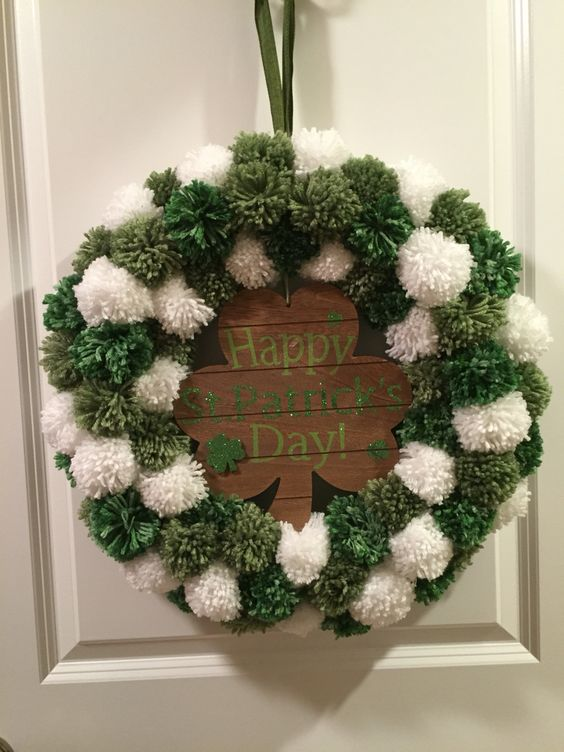 White and green pom-pom wreath for St. Patrick day.