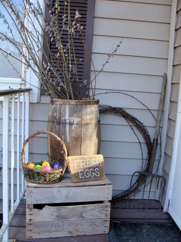 Barrel, crate and basket for Easter porch decoration.
