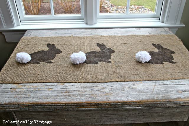 Charming burlap bunny table runner with pom pom.