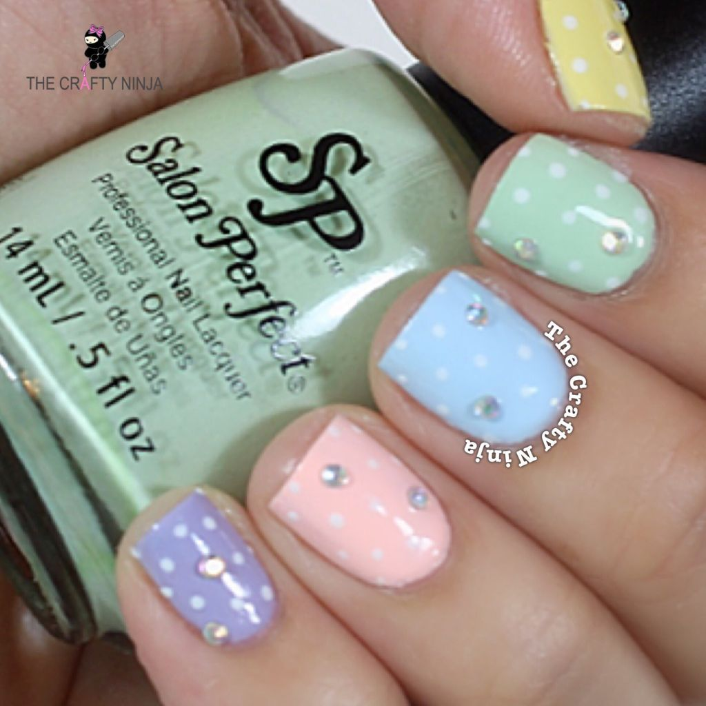 Charming pastel nails with rhinestone for spring.