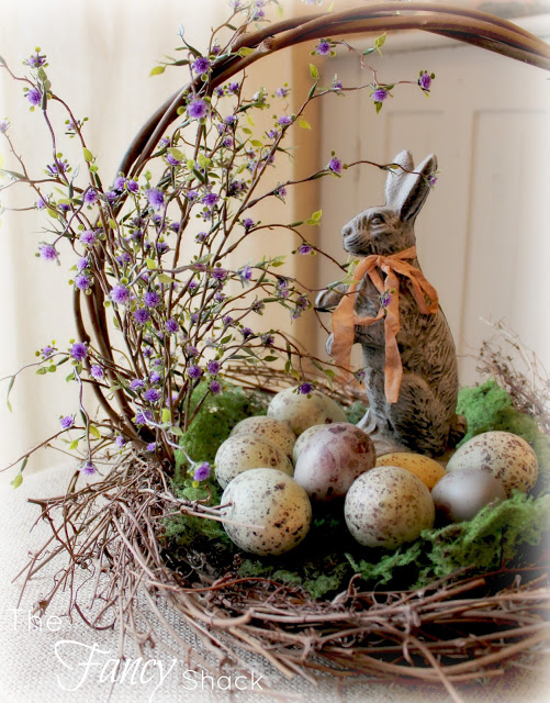 Dashing Easter basket with speckled eggs, bouquet, and bunny.