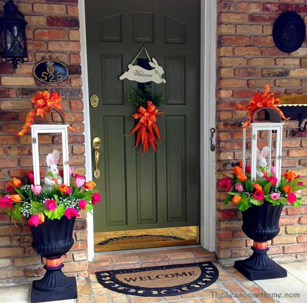 Easter bunny planter with carrot wreath on front door.