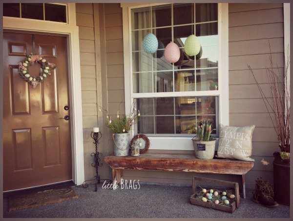 Egg shape paper lantern, old wooden crate and wreath for porch decor.