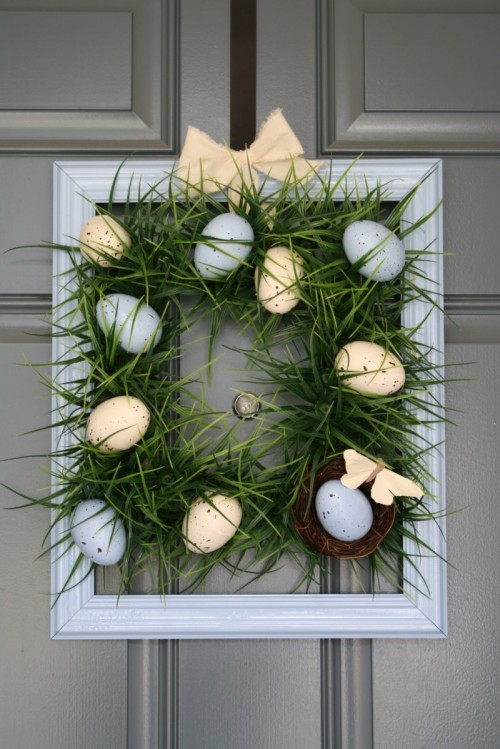 Elegant grass with Easter egg wreath for front door.