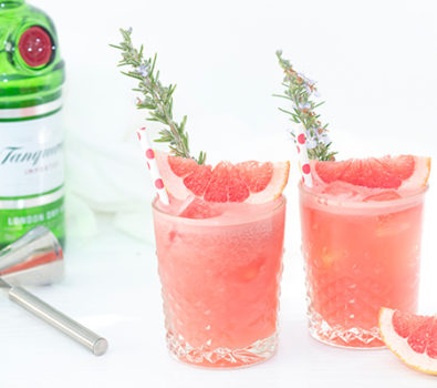 Herbal flavour cocktails garnish with fresh rosemary and pink grapefruit slices.