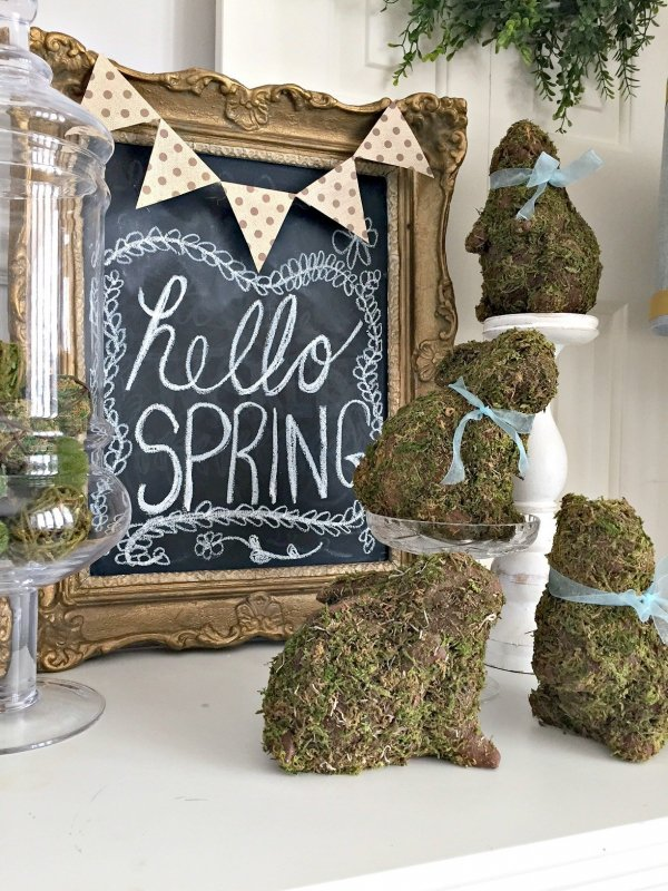 Mossy bunnies and ornate framed chalk board.