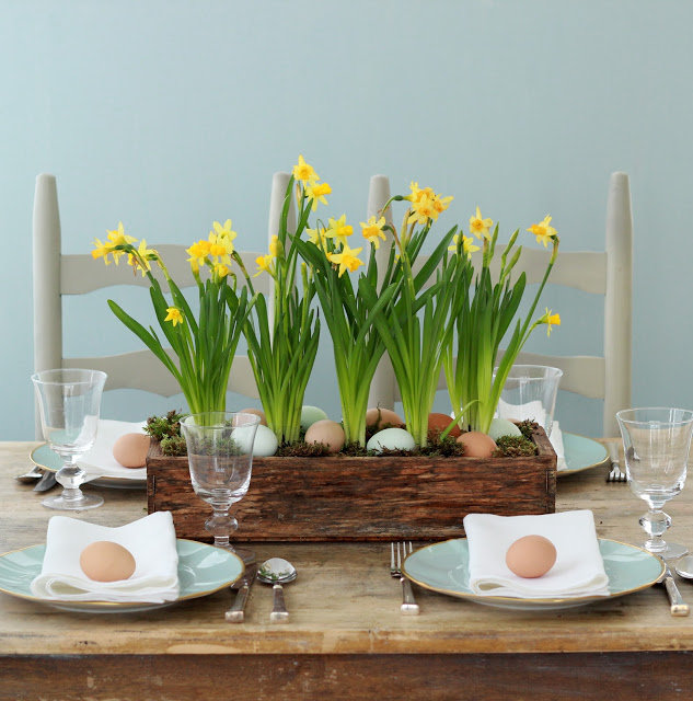 Old wooden flower planter with eggs as centerpiece.