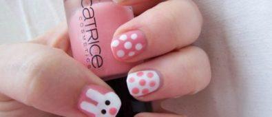 Pink and white polka dots bunny nails.