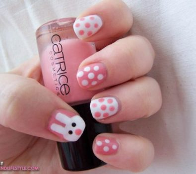 Pink and white polka dots bunny nails.