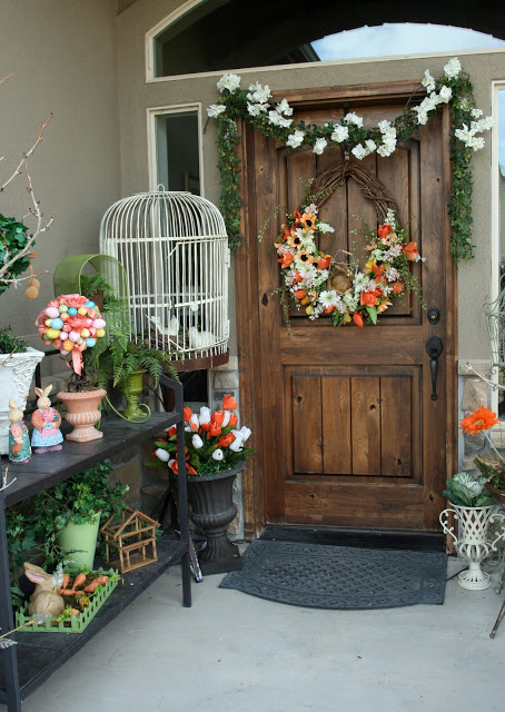 Pretty floral wreath and garland on porch.