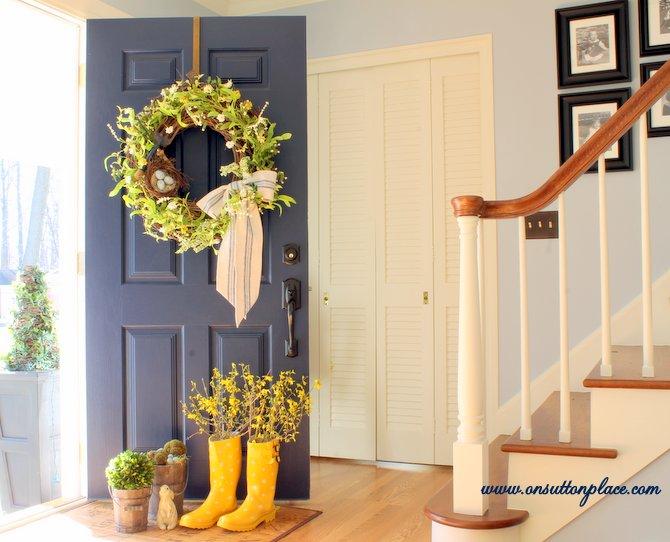 Rain boot vase with egg wreath.