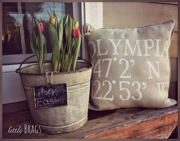 Recycled metal bucket Easter planter for porch decor.