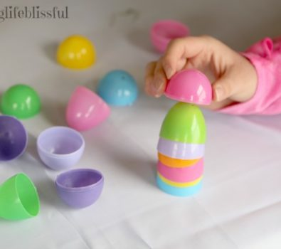 Stacking of plastic egg to make tower.