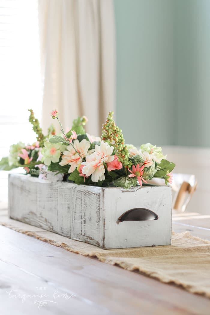 White wooden box flower planter as centerpiece to wow your guests at Easter.