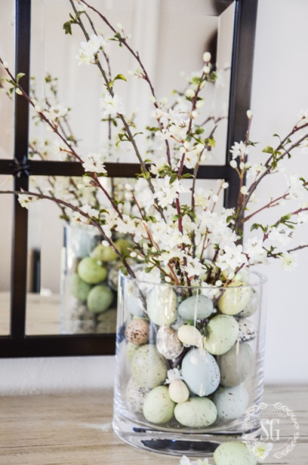 Faux speckled eggs with flowering branches.