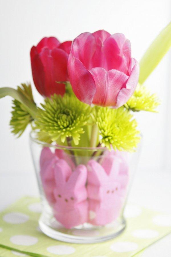 Pink marshmallow treats around the edge of the vase.