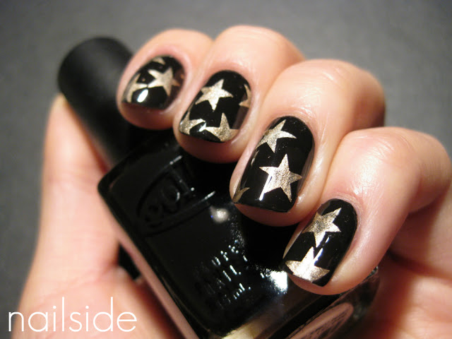 Black nails with golden stars.