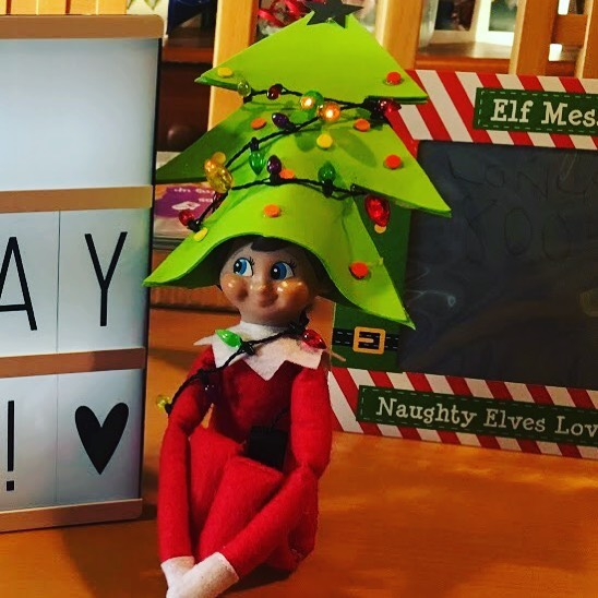 Charming elf on shelf Christmas tree.