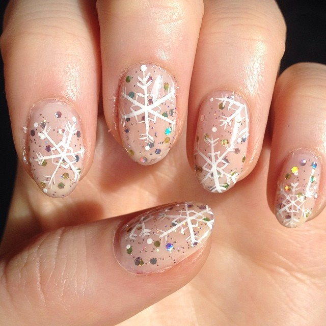 Dashing snowflake nails.