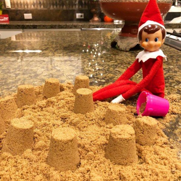 Elf busy in making sand castle.
