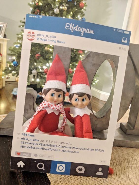 Elf on shelf in instagram frame.