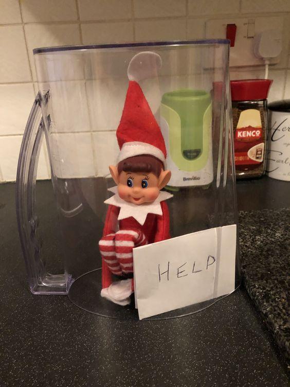 Elf on shelf stucks in glass jar.