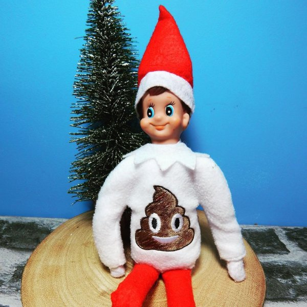 Elf on shelf with ugly poo sweater.