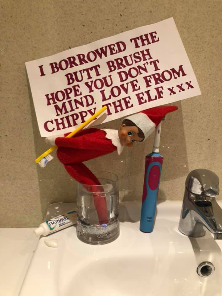 Funny elf on shelf with message.
