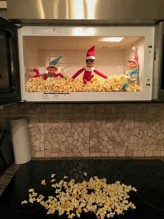 Playing with popcorns in microwave.