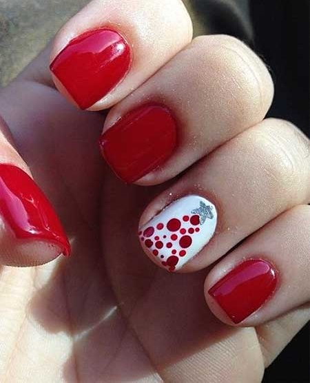 Red & white nail with polka dots tree.