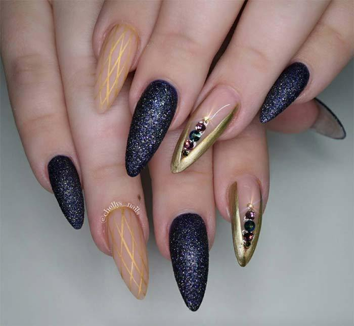Stiletto gold and purple nails.