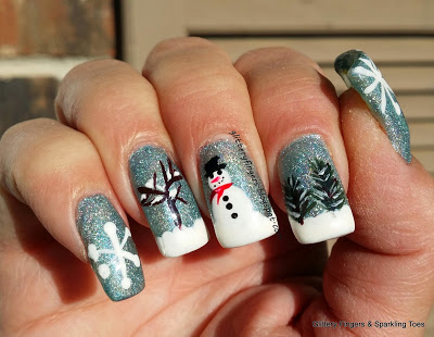 Stunning snowy nails.