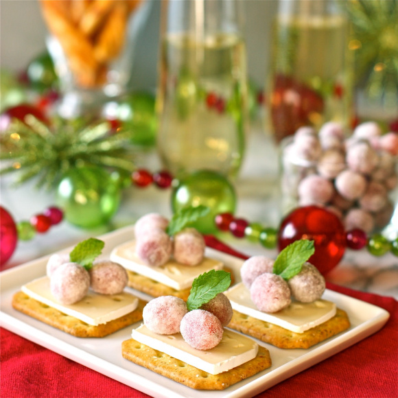 Brie bites with sugared cranberries.