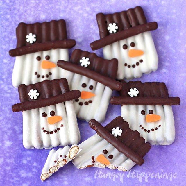 Chocolate snowman pretzel popsicle sticks.