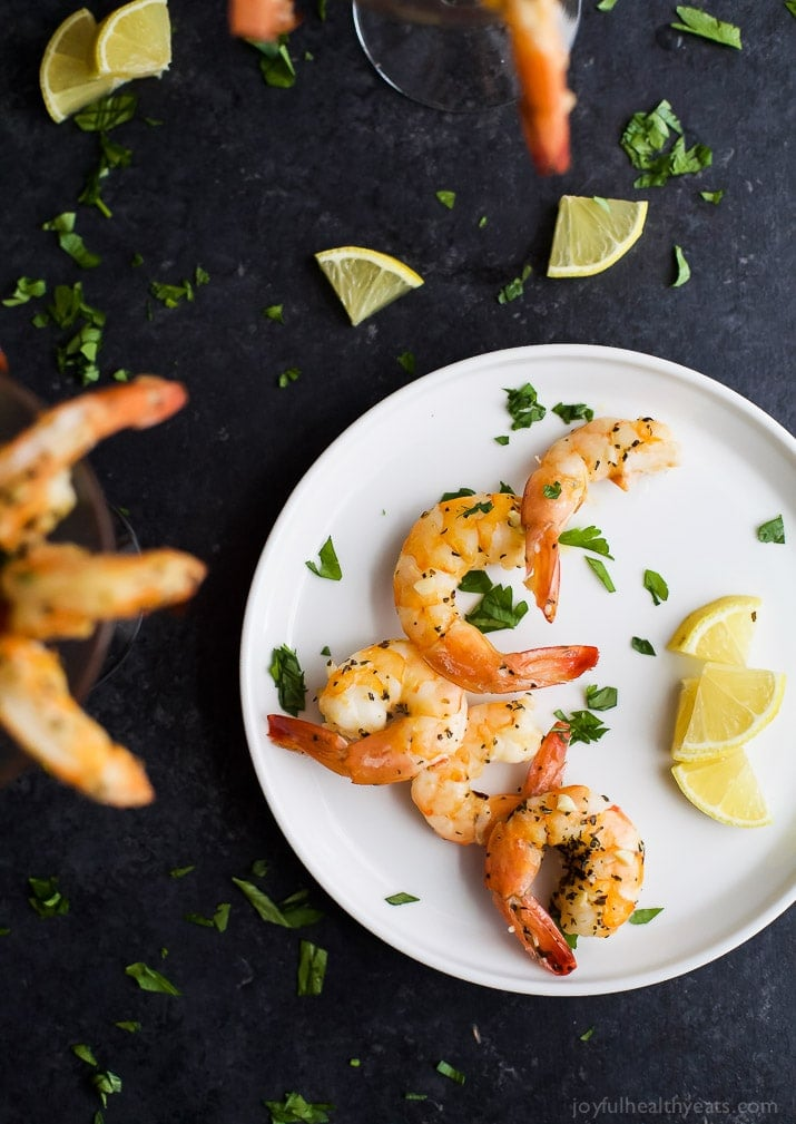 Garlic herb roasted shrimp with cocktail sauce.
